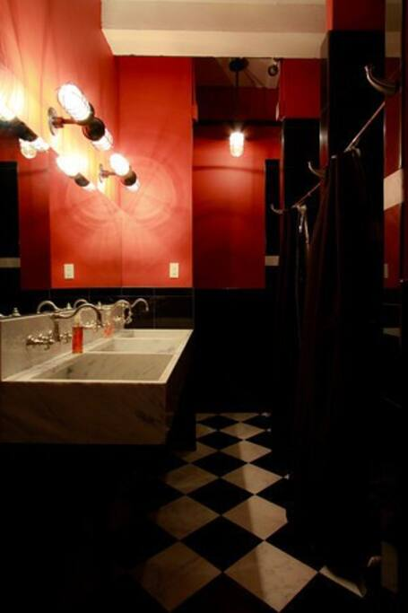 Shared bathroom has heated floors and Red Flowers bath products.
