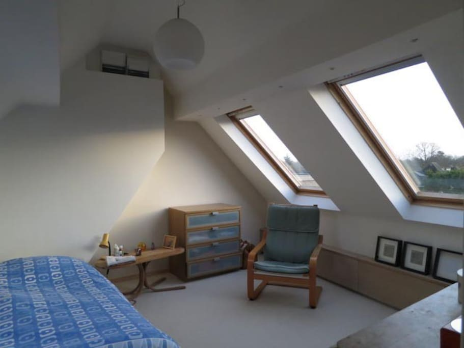 One of the double bedrooms: a spacious and luminous attic room.