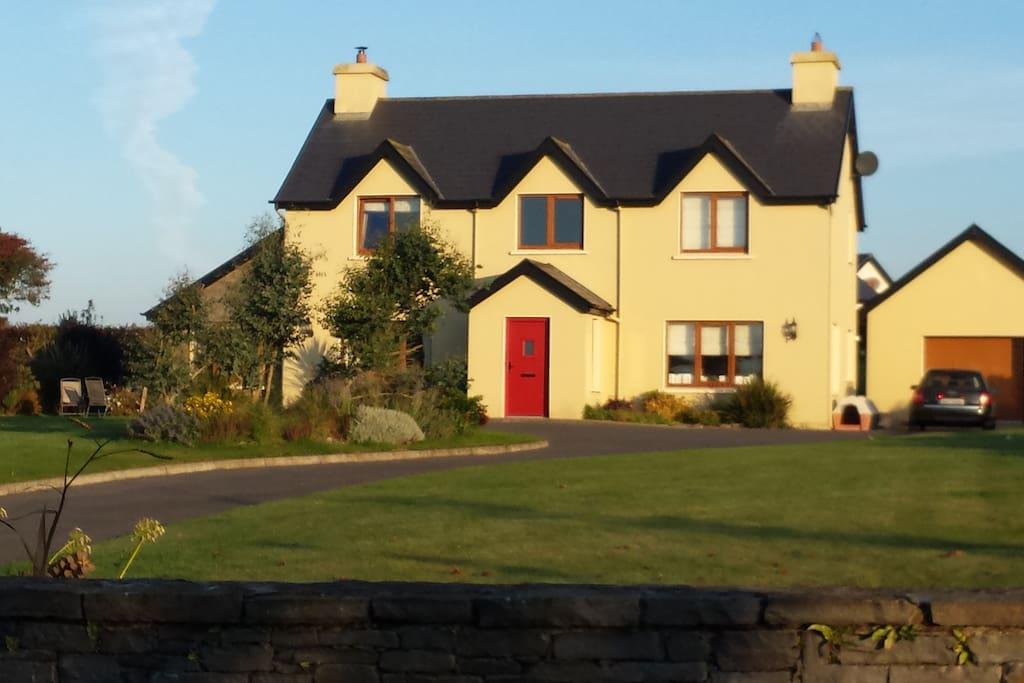 House on mature gardens
