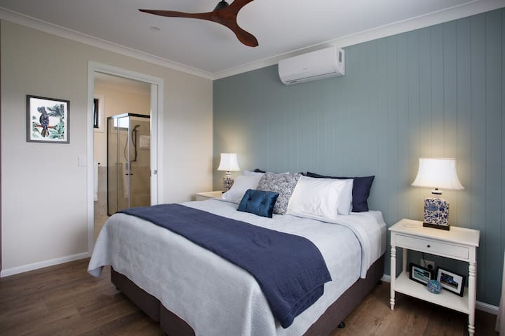 Blue room - king size bed with pillow library. (Beds can be split into singles - please advise when booking)