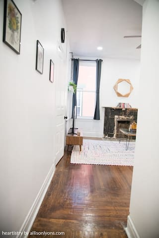 The original hardwood floors are throughout the apartment.