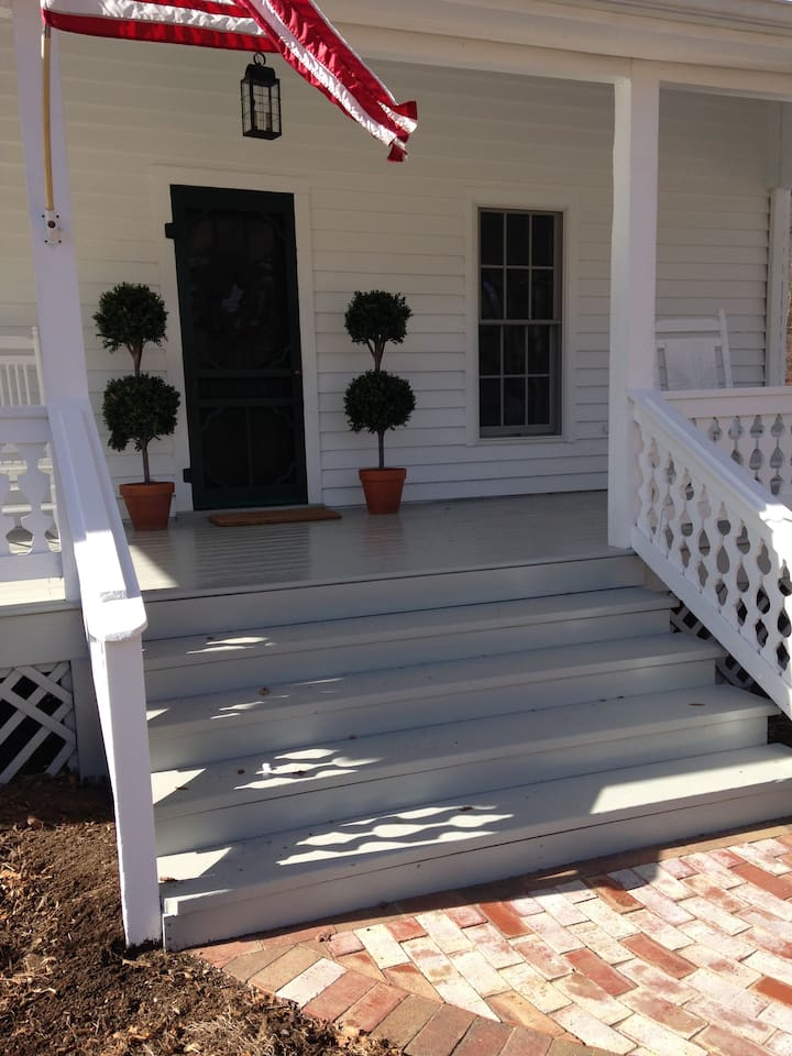 View of the front porch w/ rocking chairs