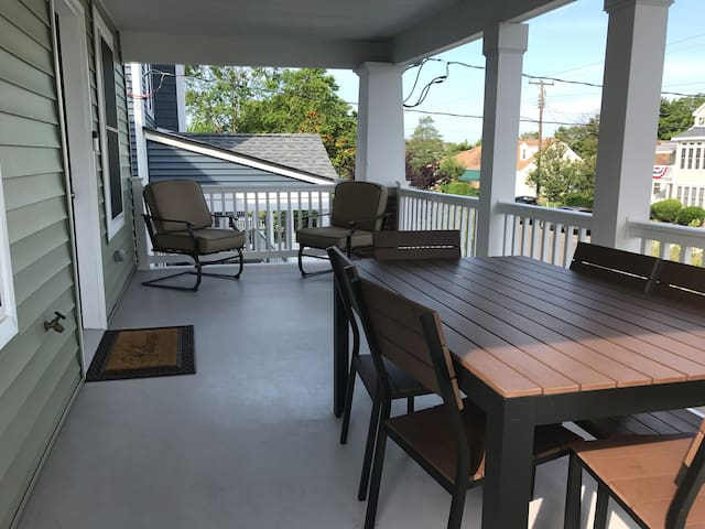 Extra large private front porch with outside dining table to seat six.