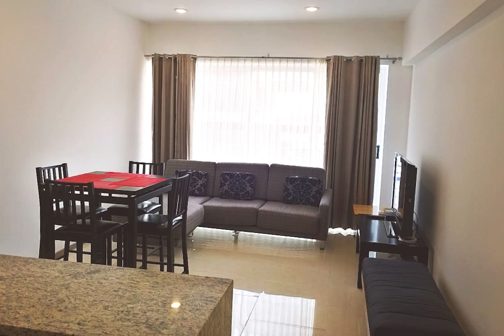 Tall chairs dinning table on livingroom with TV