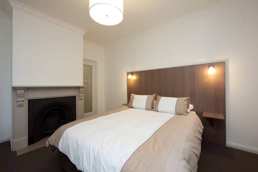 Generous queen size bedroom with ensuite and toilet
