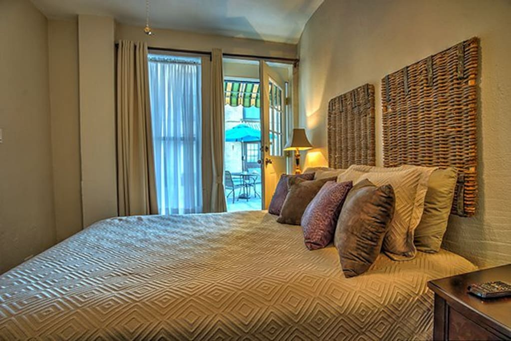 Bedrooms opens to courtyard yet has privacy drapes.  Queen Bed.  Full bath with tub/shower.