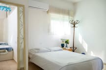 near the bedroom there is little room with 2 single beds for children