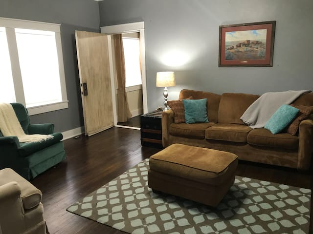 2nd living room with access to 3rd bedroom and 2nd full bathroom.