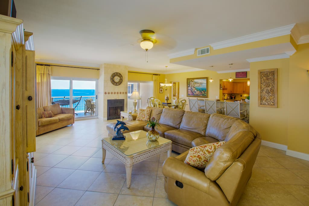 Great room with leather sofa and fabulous Gulf views.