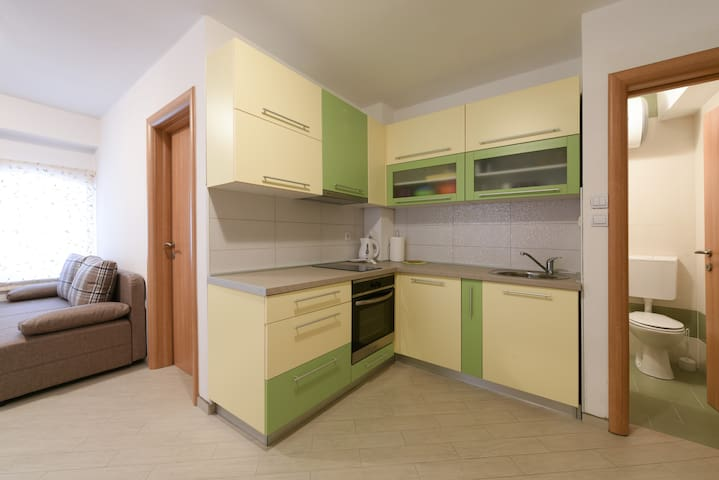 Apartment Prukljan, kitchen part of room