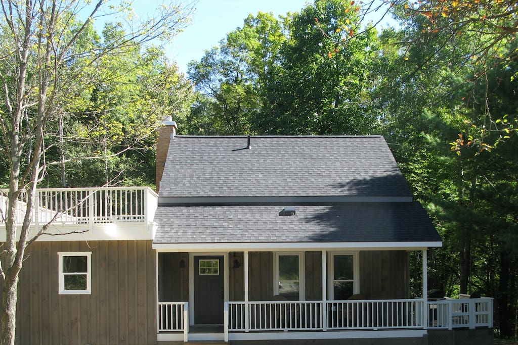 The front view of Golden Glen.  It is so inviting.  You can see the front porch and top deck.  Perfect places to look for wildlife or sip a drink and listen to the birds.