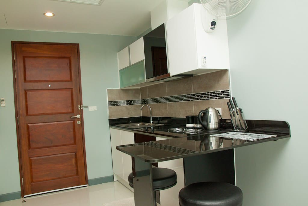 Kitchenette with double ring ceramic hob, extractor hood breakfast bar, soft close cupboards etc