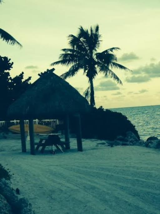 Tiki hut, and grill on our private beach.
