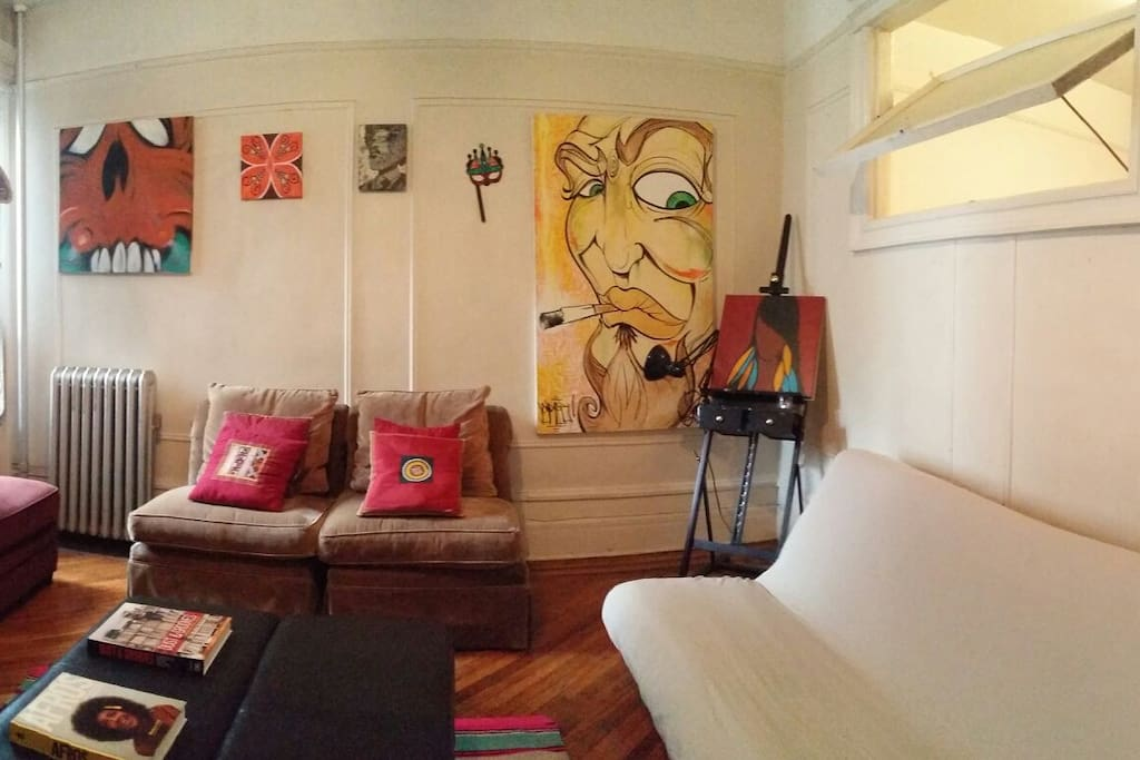 This is a panoramic view.  the Sofa to the right is a Futon which folds flat into a Full Size (double bed, sleeps two) bed.
