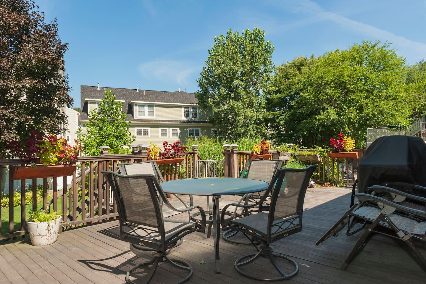 Direct deck access overlooking a  spacious yard and garden.