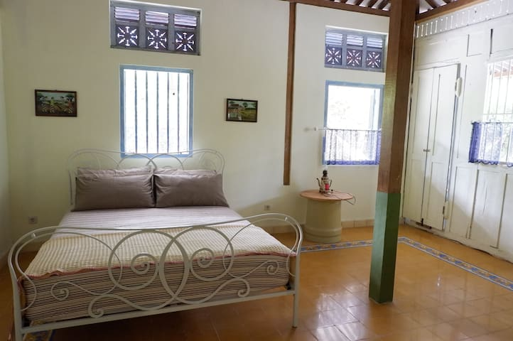 Our main bedroom with one queen bed that can be used for two people