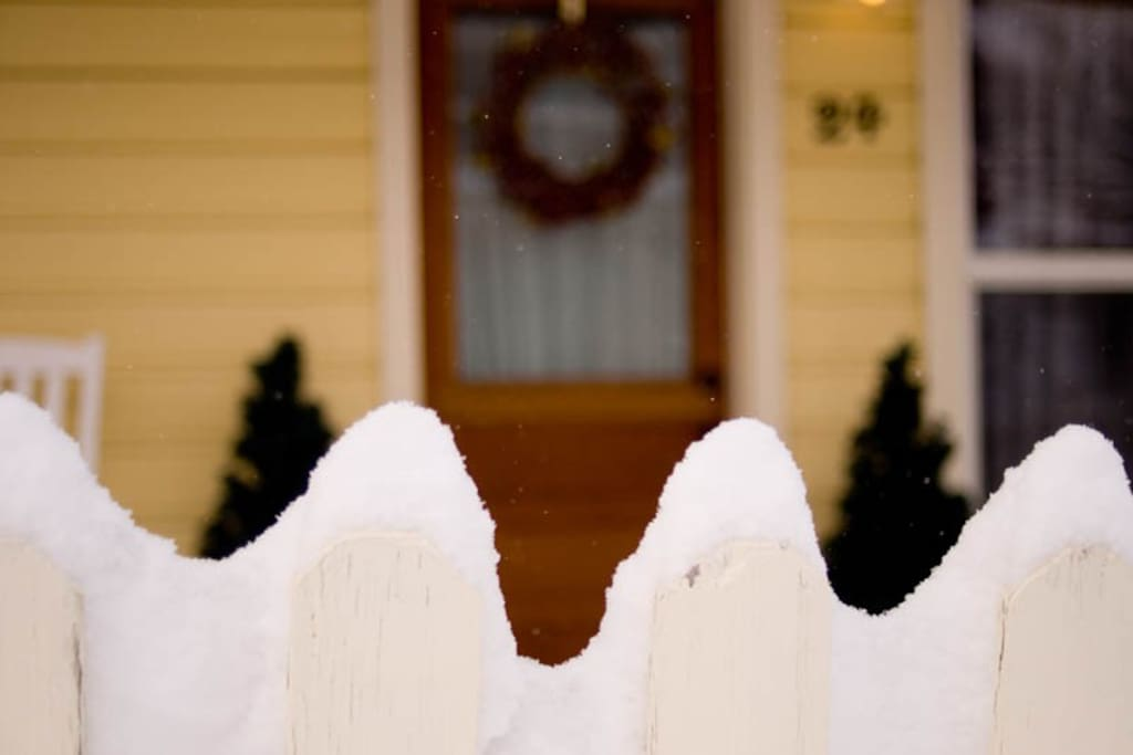 Fresh powder snowfall on the picket fence outside the 24 Daly Home.