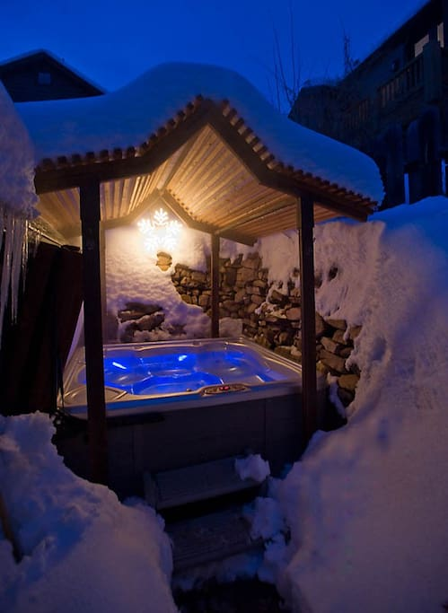 Outdoor spa grotto with high power hot tub.