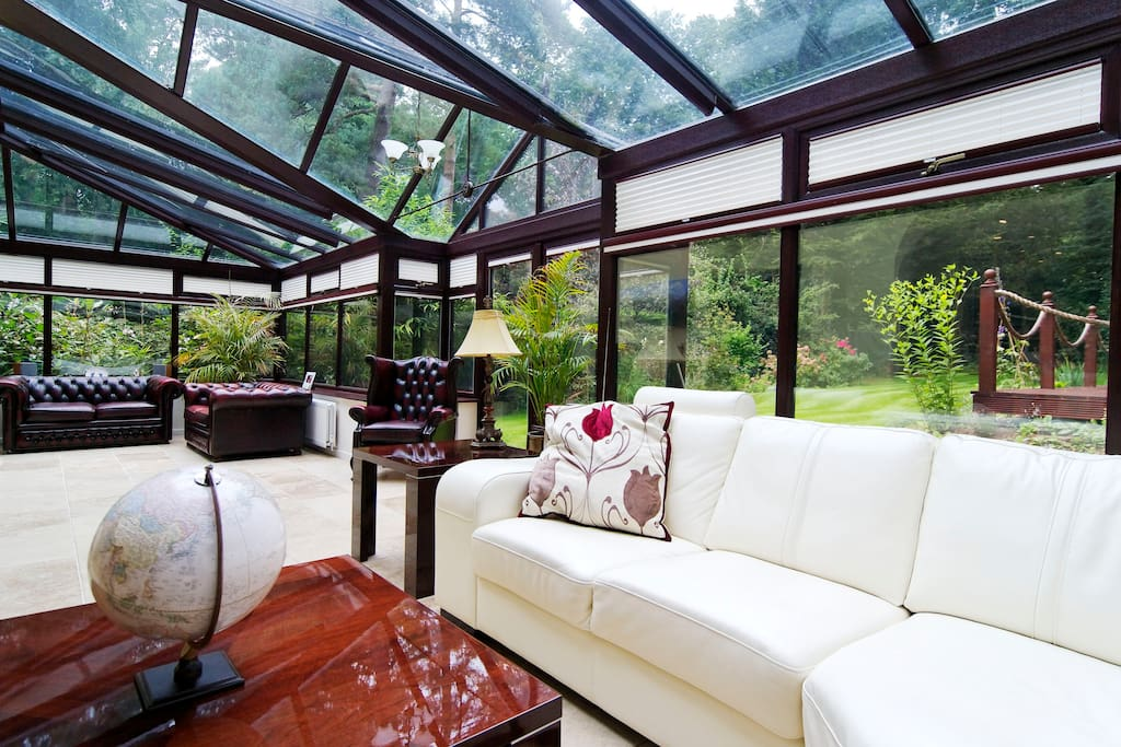One of the sitting areas within our large conservatory overlooking the rear garden