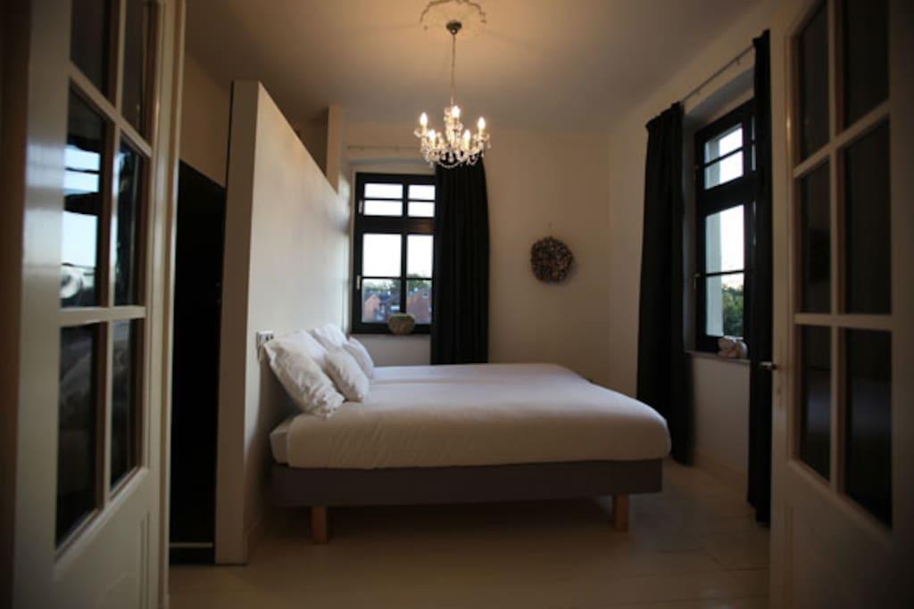bedroom with bathroom (shower & washing basin)