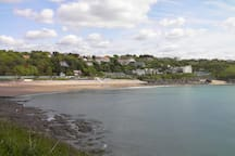 Langland Bay with its  Victorian beach huts.