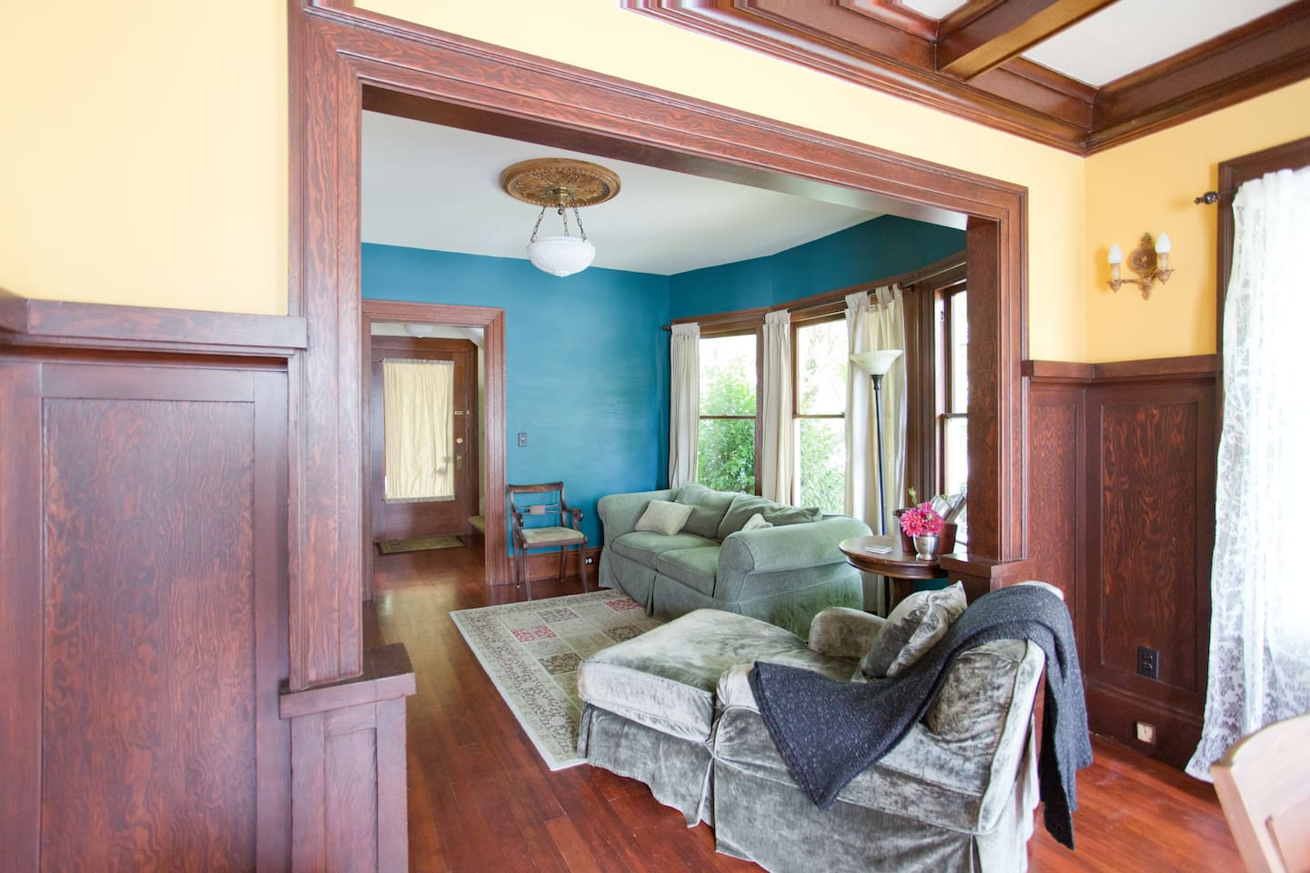 Living room sofa and chaise adjacent to the dining room.