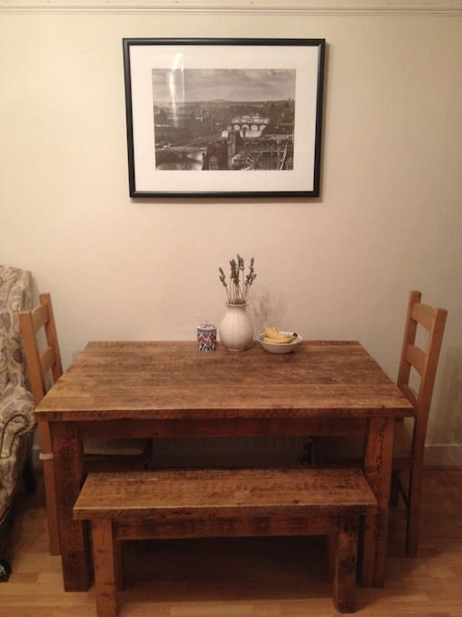 Large table, bench and chairs in eat in kitchen