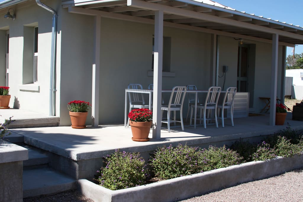 Side Porch with outdoor table and six chairs.