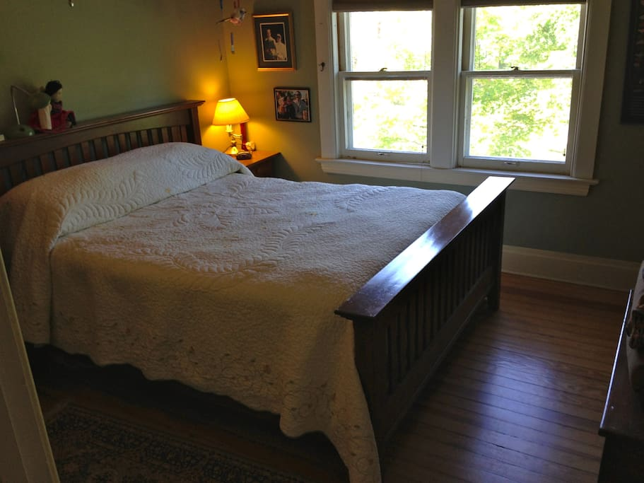 Queen bed in master bedroom.  Mission style bed made by home owner Jeff.