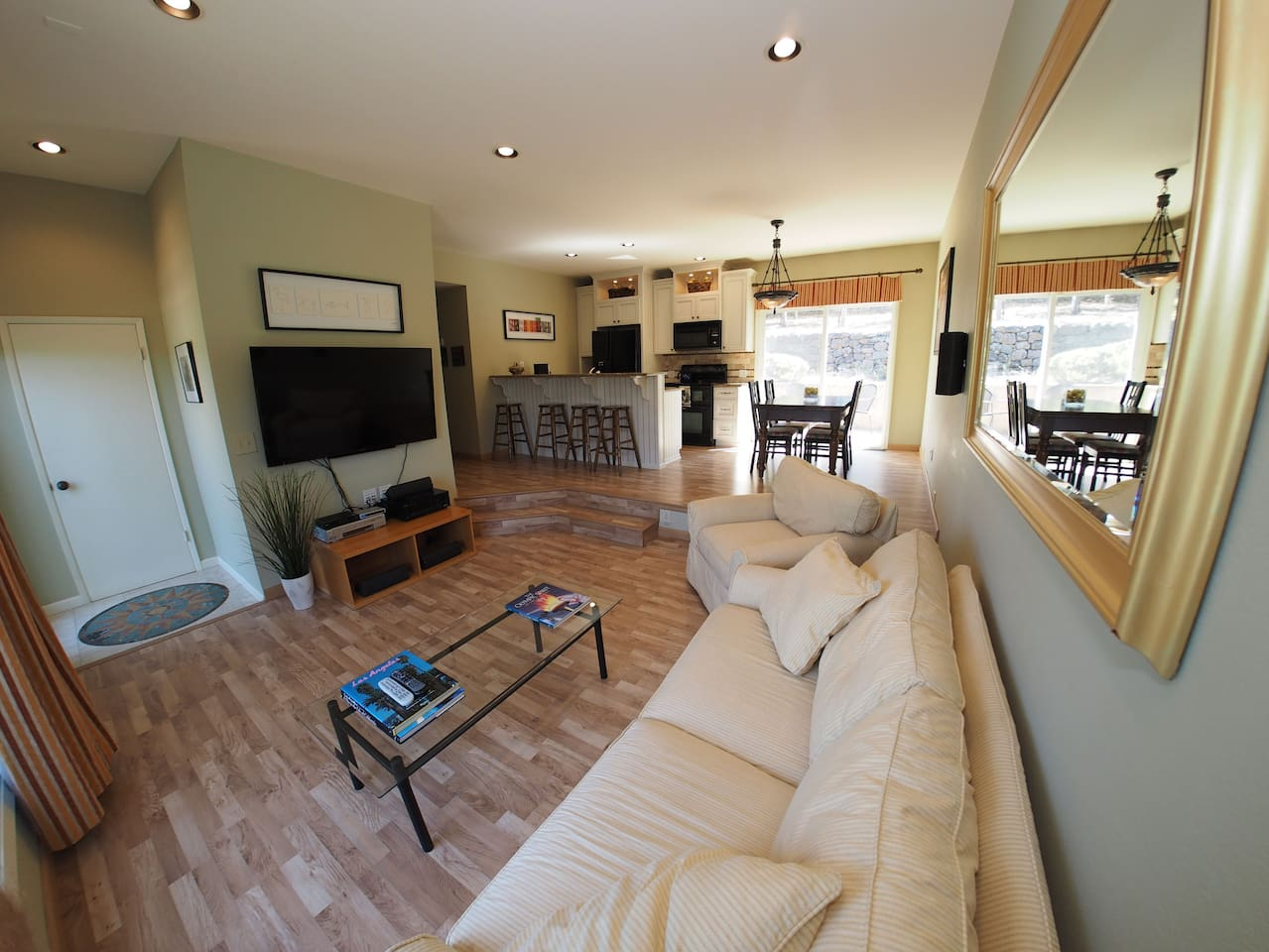 Open floor plan among entry, living room, kitchen and dining area