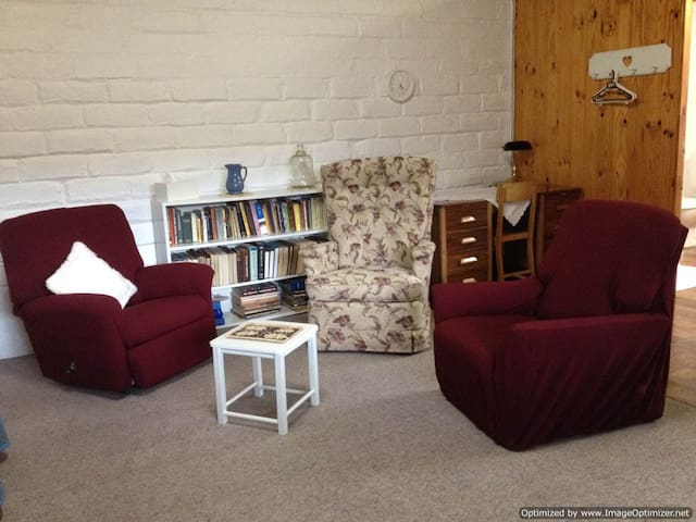 Comfy chairs to sit relax/read. Why not write a note at the 1940's restored writing desk.