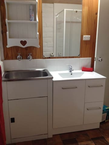 Bathroom has new vanity, shower, toilet and laundry basin only facility.