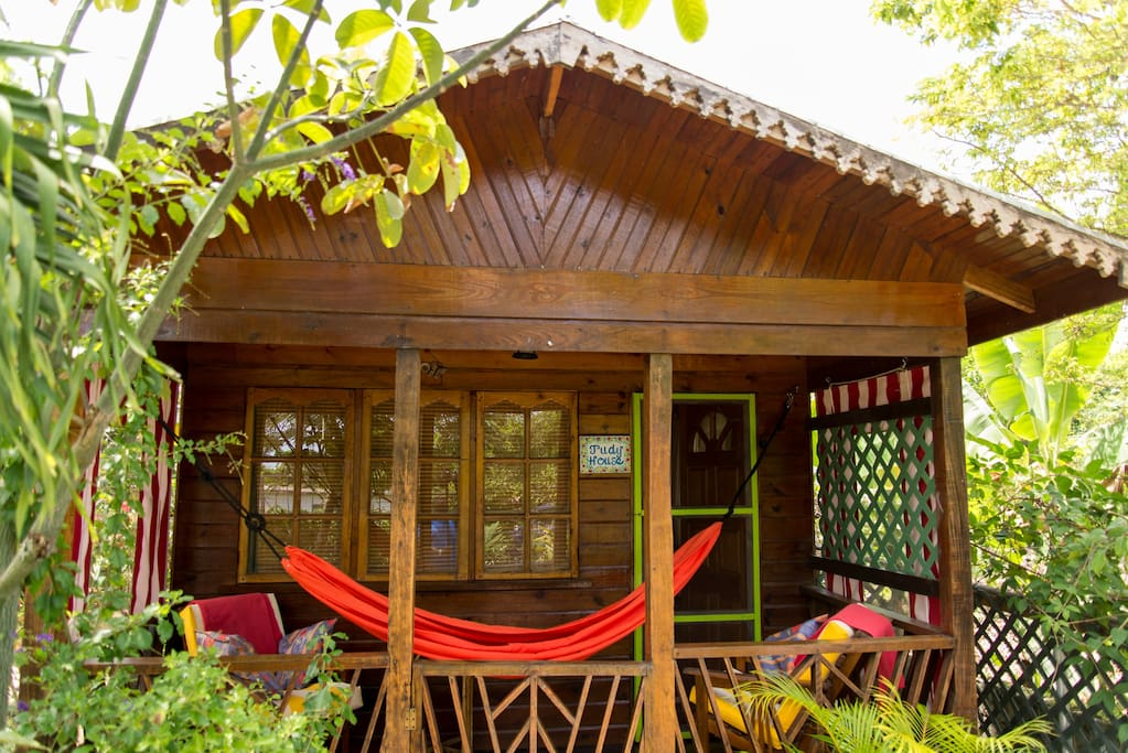 The Judy House Veranda with hammock and comfortable table & chairs