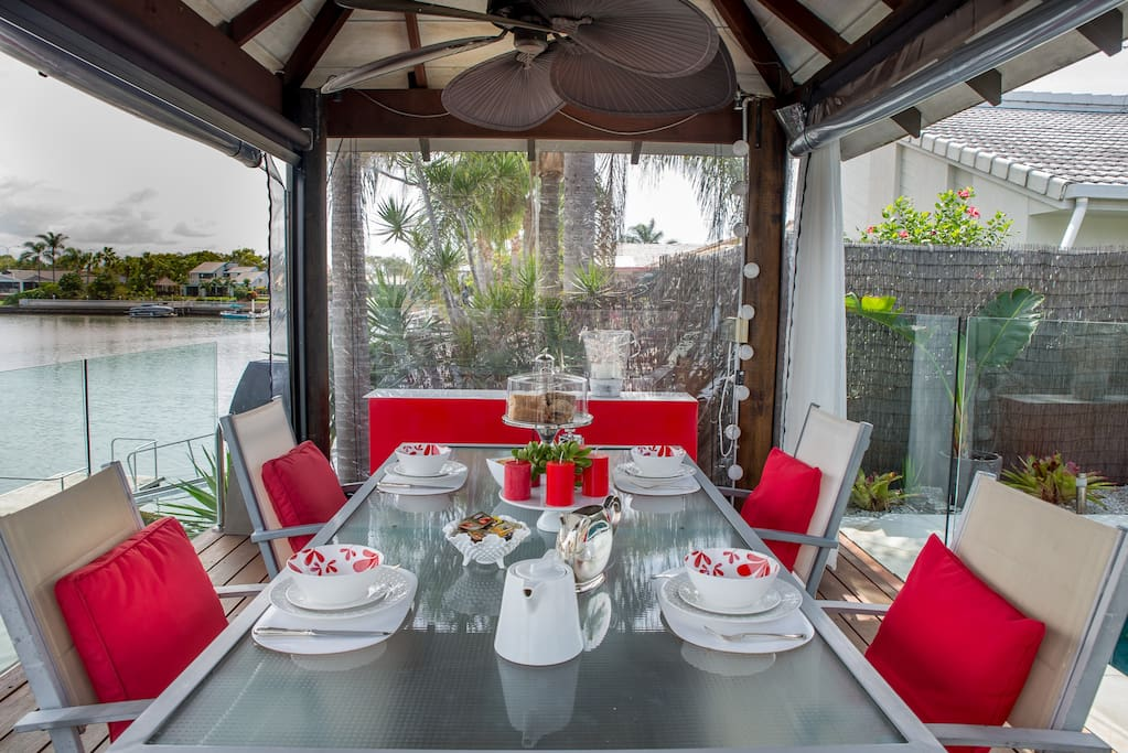 Dining table in the Cabana on the waterfront at B and B on the Bay your Gold Coast Accommodation