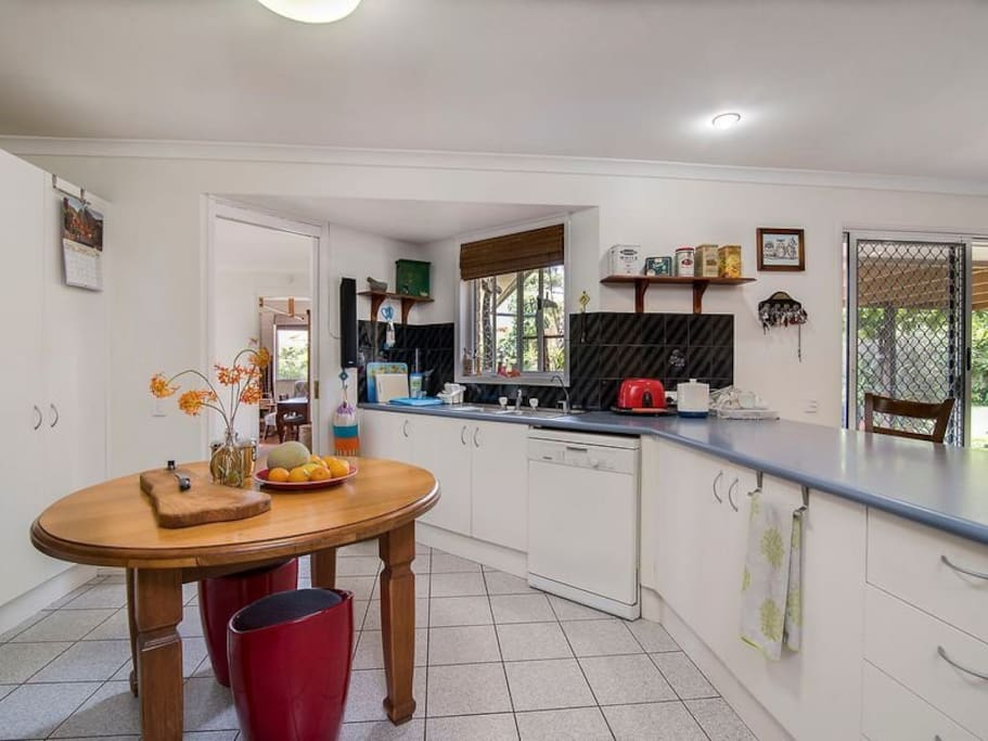 Large, open plan kitchen with dishwasher