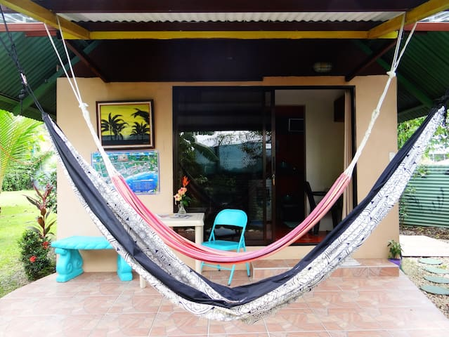 Entrance, chill out terrace, table and hammocks!