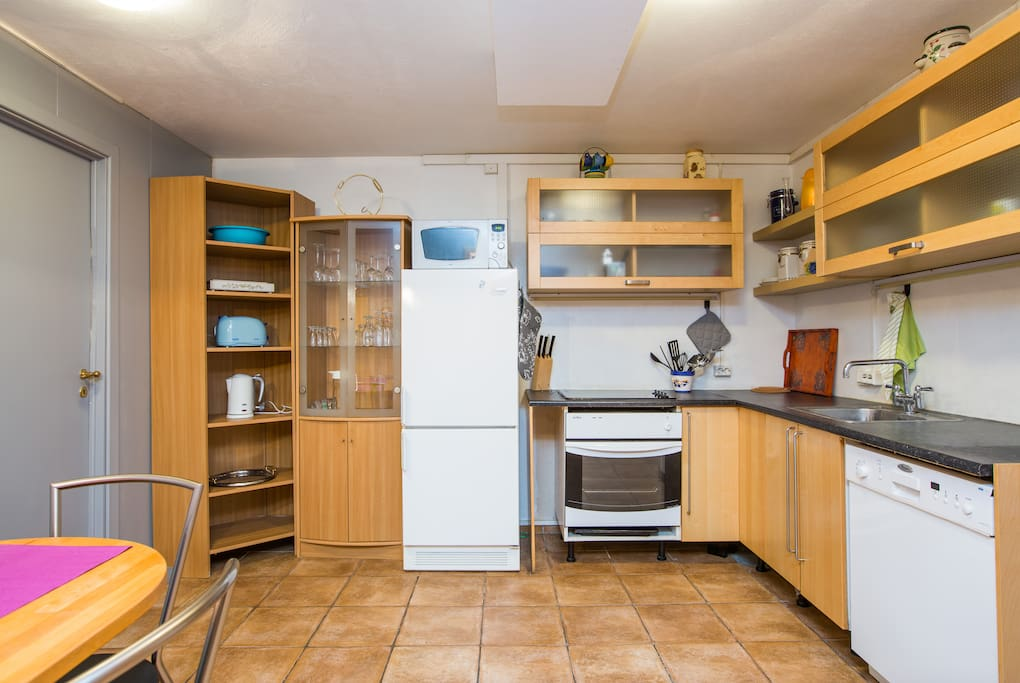 Kitchen includes a fridge with freezer, dishwasher, microwave and oven among other essentials.