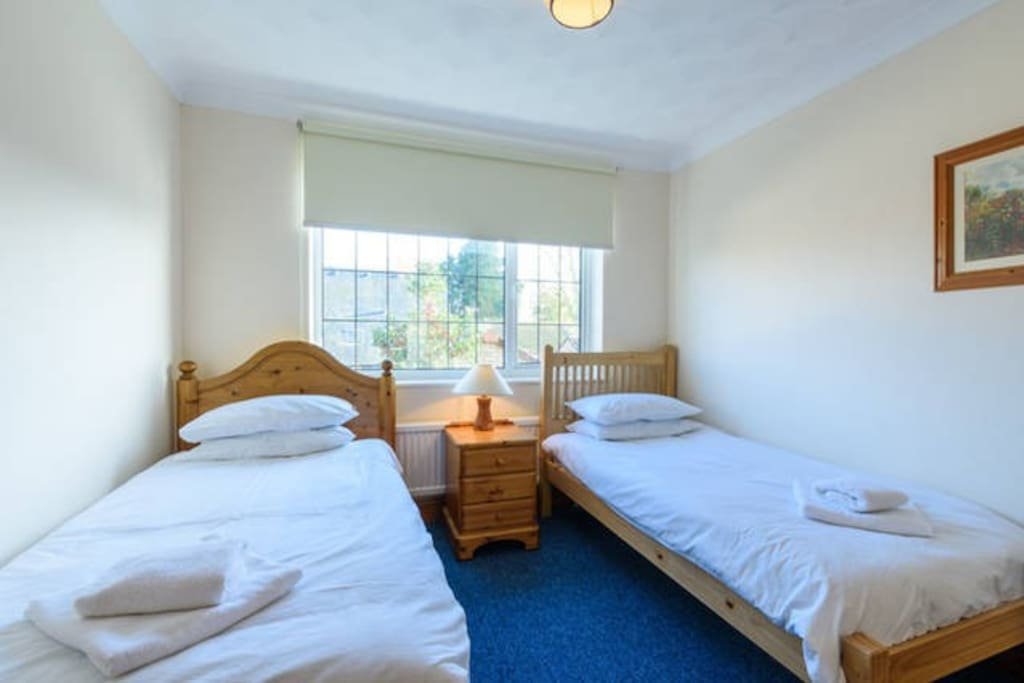 This room has 2 single beds, bedside cabinet, desk, chest of drawers and wardrobe.