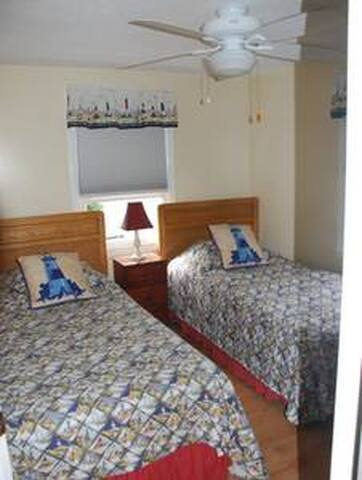 Bedroom - 2 NEW twins, Darkening Shades!, Large Fan, Chest of Drawers, Closet w/ AMPLE hangers.