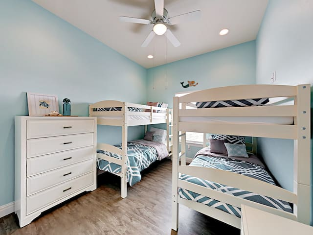 Great for kids, the 3rd bedroom has a pair of twin-over-twin bunk beds.