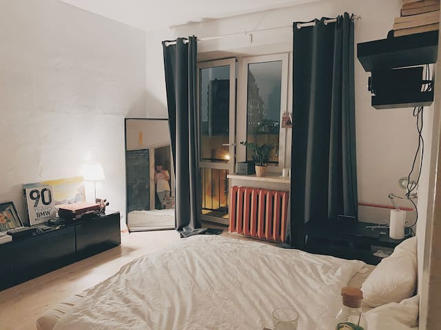 Bright and cozy apartment with a projector