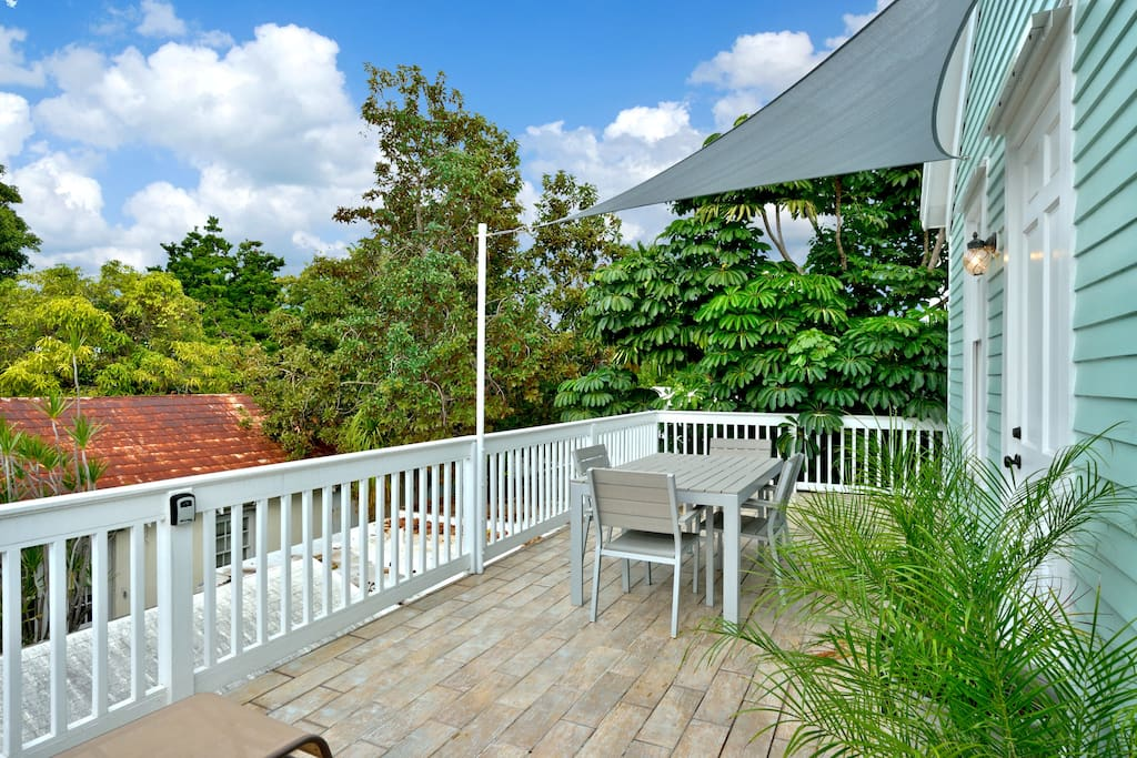 Private upstairs balcony with view of neighboring homes