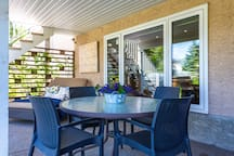 Outdoor patio right outside your door looking onto to a huge garden