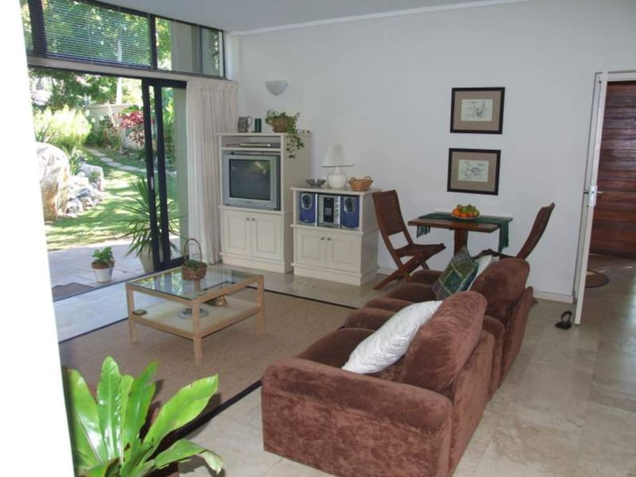 Living room with direct access to garden &  patio + pool