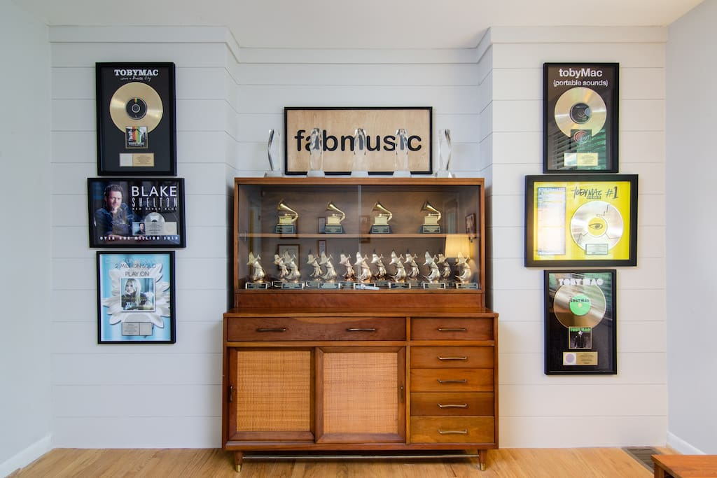 Authentic Grammys and other awards on display throughout the living room!
