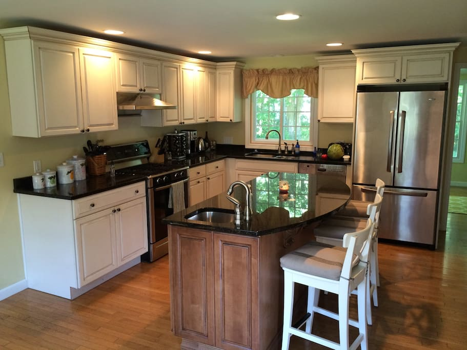 Spacious kitchen is equipped with new appliances to meet all your culinary needs