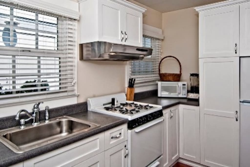 Full kitchen with fridge,oven,microwave,coffeemaker,blender,all you need to cook.