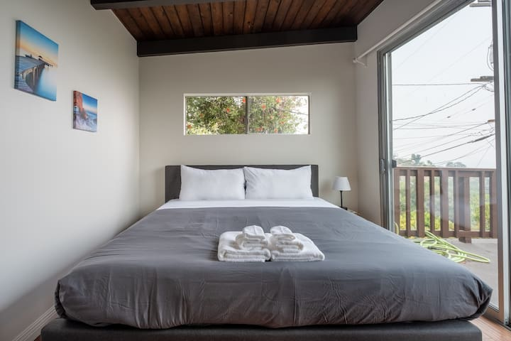 Bedroom with king bed.