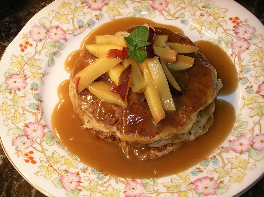 "Made-from-scratch pancakes with caramel sauce & fresh peaches at Brick House on Main Bed & Breakfast. We like to call it ""Happiness on a Plate""."