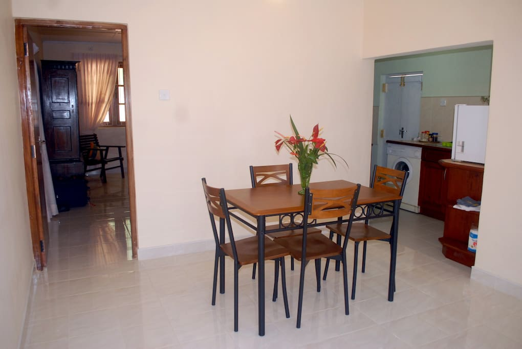 Dining room with fully equipped kitchen